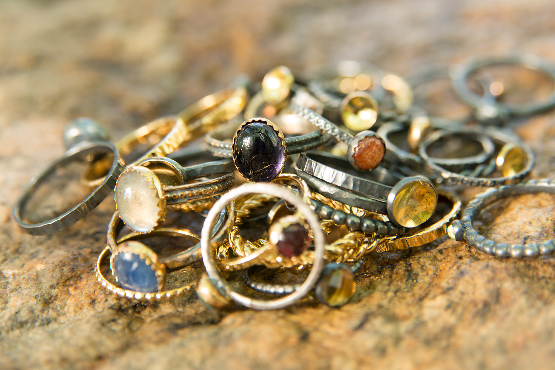 Photographer for product advertising pile of handmade gold rings