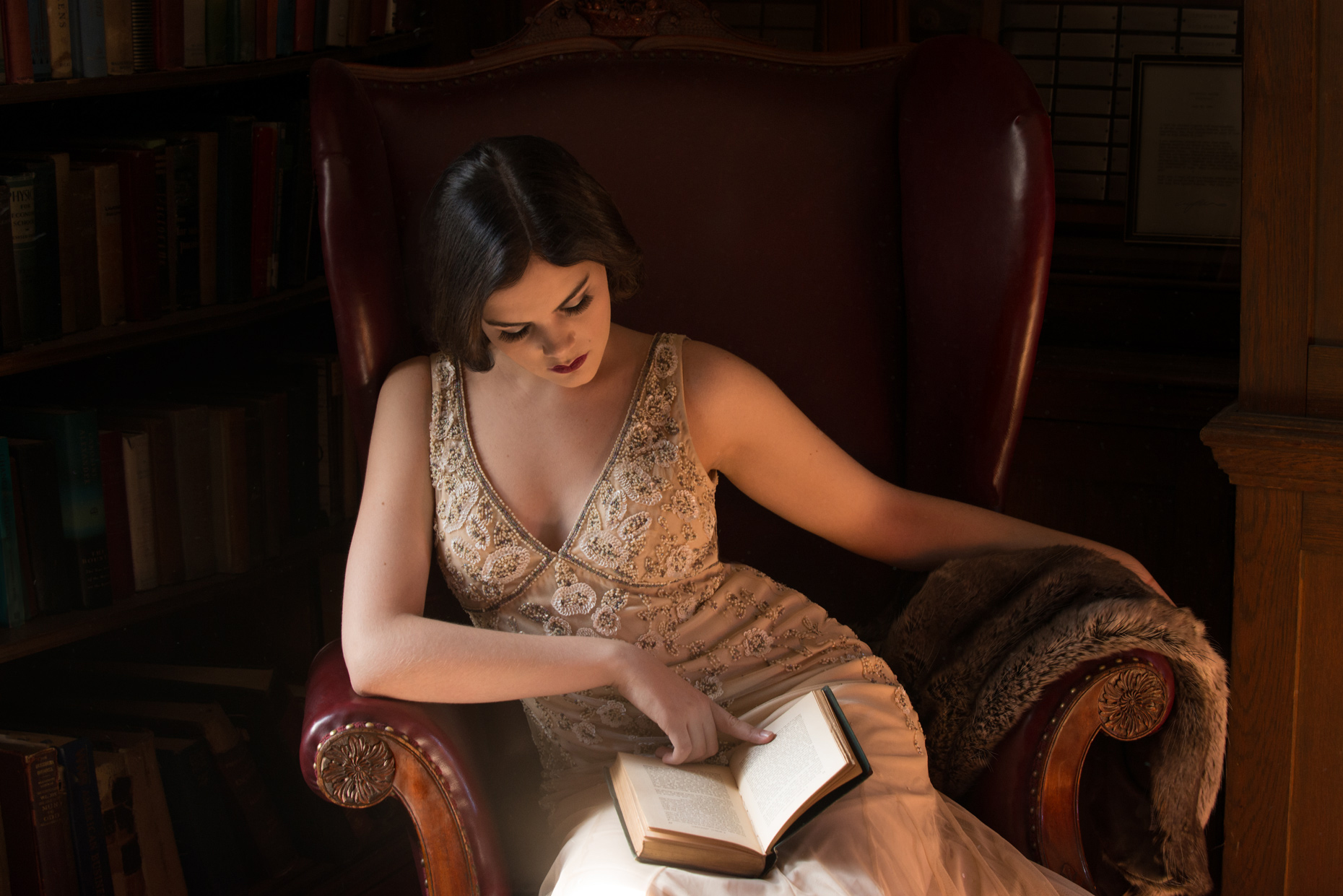 Woman in a vintage gown sitting in a chair and reading Conceptual Portrait Photographer in Boston