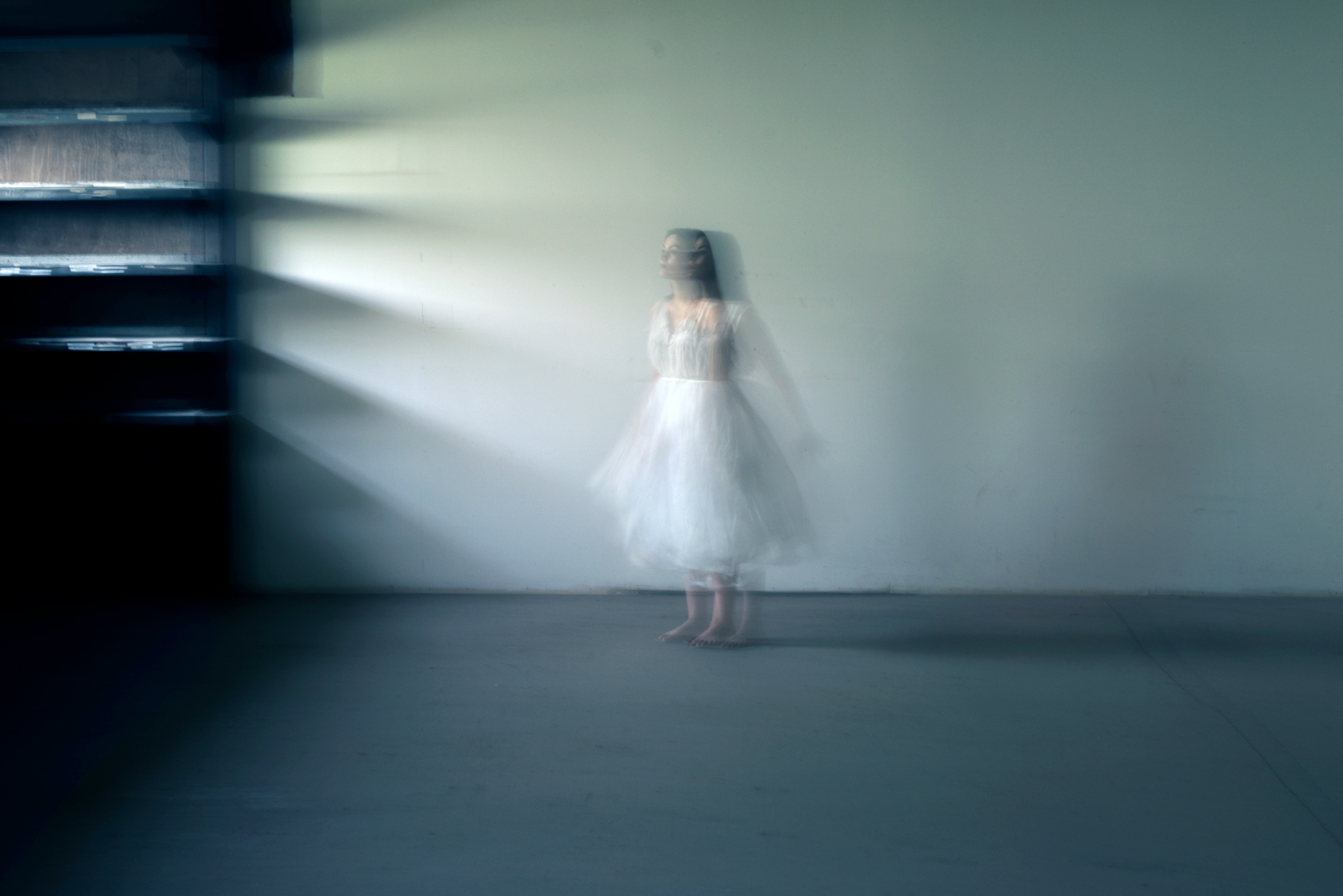 Photograph of a ghost woman in a room environmental portrait