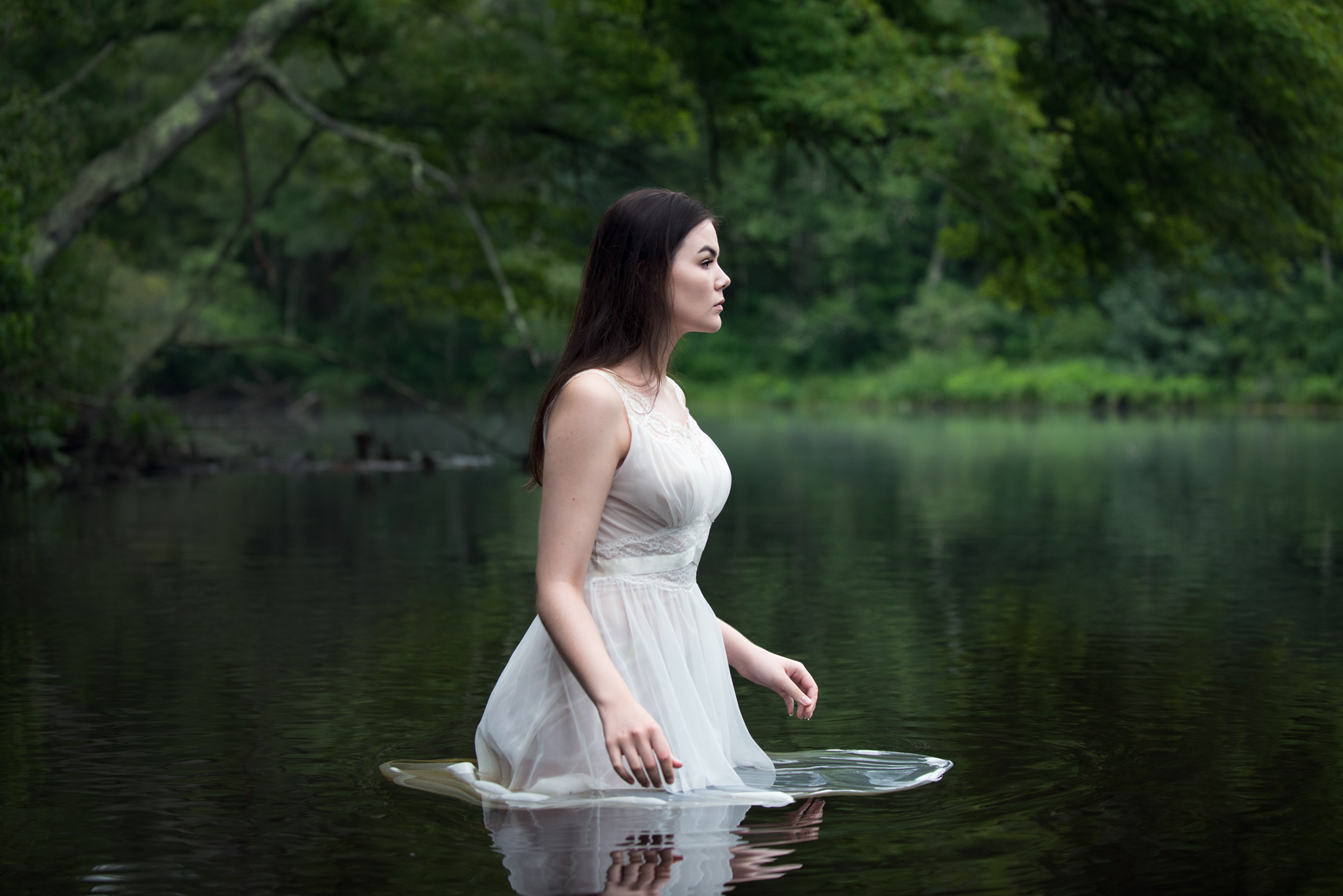 Fine concept art portrait Woman in white submerged in a river