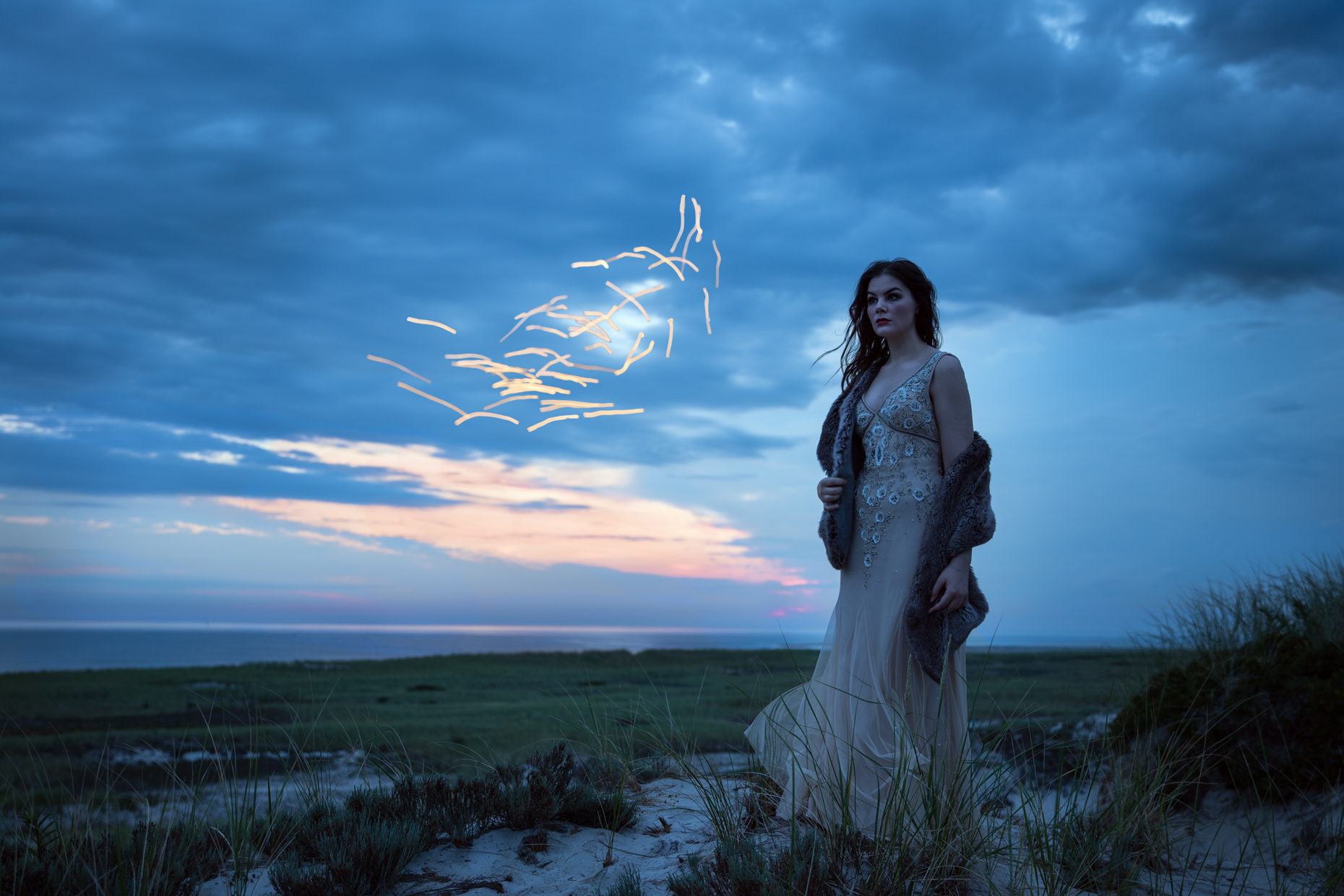 Woman in a gown standing on a sand dune at sunrise Conceptual Portrait Photography in Boston